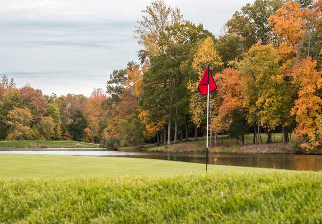 A fall day view of a hole at Hermitage Country Club.
