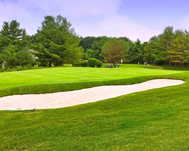 A view of a hole protected by a tricky bunker at Somers National Golf Club.