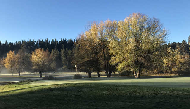 A fall day view of a green at Mace Meadow Golf & Country Club.