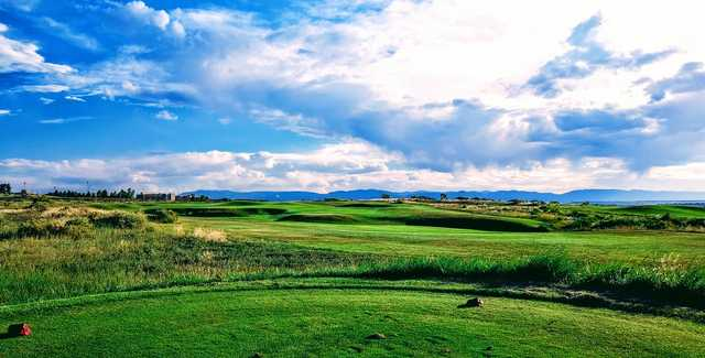 A sunny day view from the red tee at Walking Stick Golf Course.