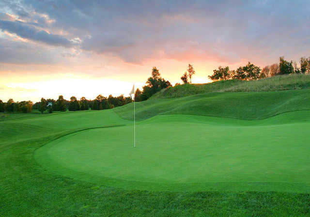 A sunset view of the 1st green at Blue Mash Golf Course.
