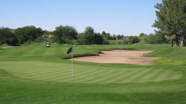 A view of a green protected by a tricky bunker at Stonecreek Golf Club.