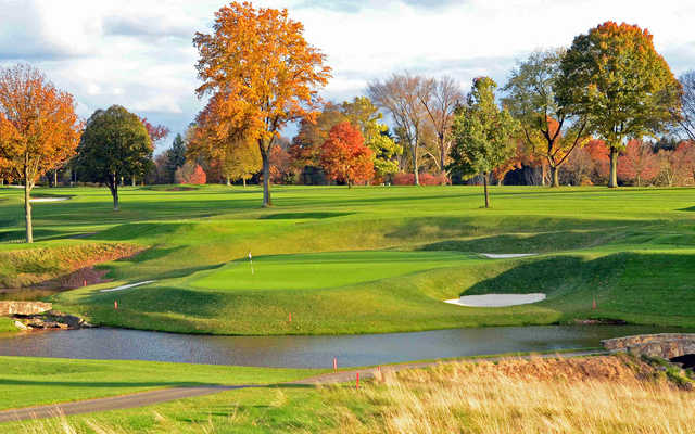 A fall day viw of a green with water and bunkers coming into play at Pittsburgh Field Club.