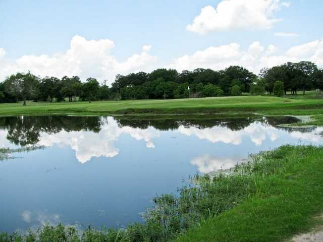 A view over the water of green at Bryan Golf Course