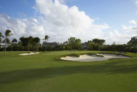 A view of a green protected by bunkers at Pine Tree Golf Course