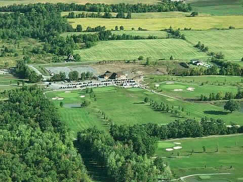 Aerial view of the clubhouse and driving range at Lima Golf & Country Club - Island Oaks