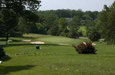A view of green #11 surrounded by bunkers at Bel-Wood Country Club