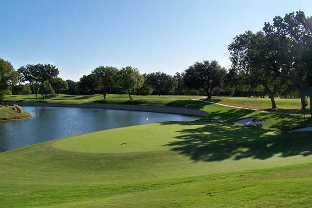 A view of a green with water coming into play from left at Colonial Country Club.