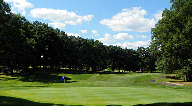 A view of a green and a fairway at Keney Park Golf Club