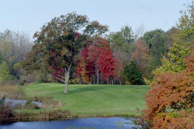 A view over the water of green at Meridian Sun Golf Club