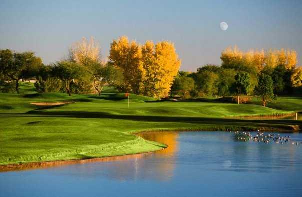 A fall view over the water of green at Stonecreek Golf Club