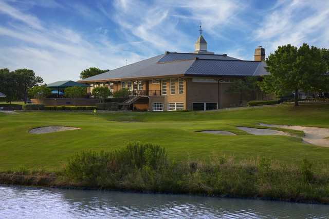 A view of the finishing hole and the clubhouse at Hackberry Creek Country Club