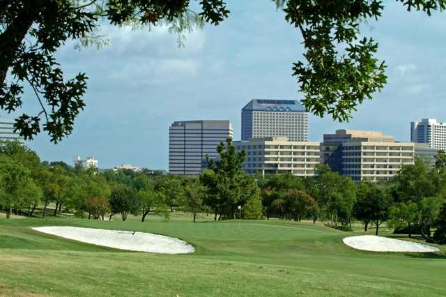 A view of a green flanked by bunkers at Las Colinas Country Club.