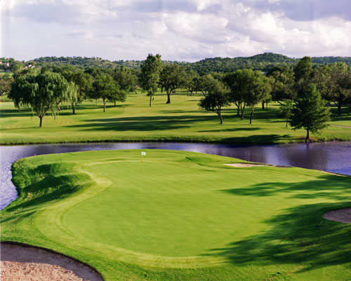 A view of green #7 surrounded by water at Riverhill Country Club
