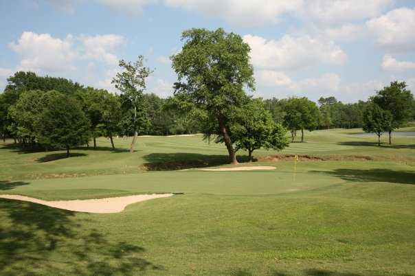 A view of a hole protected by bunkers at Hollytree Country Club