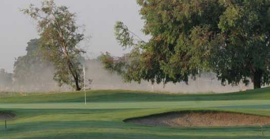 A view of green protected by bunker at Lemoore Golf Course