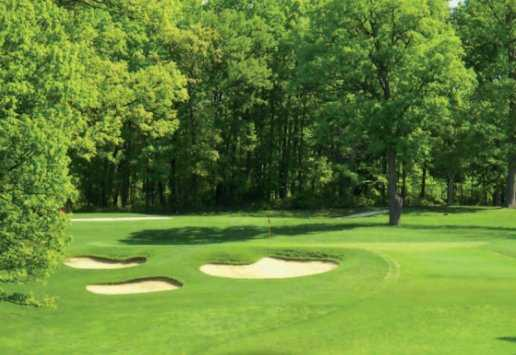 A view of a green protected by bunkers at University of Maryland Golf Course