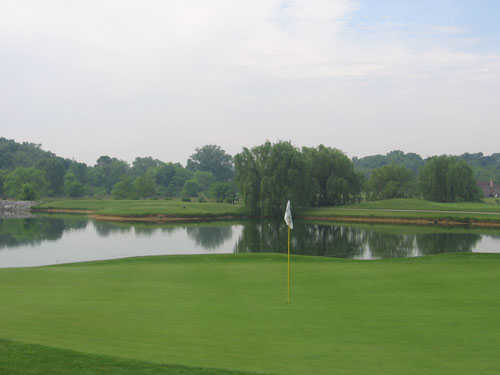 A view of green #16 with water coming into play at Locust Hills Golf Course