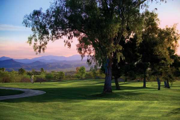 A view from 	Rancho de Los Caballeros Golf Club with mountain in background