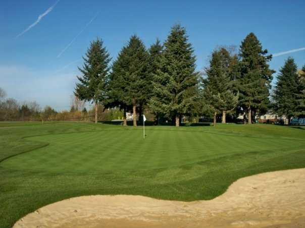 A view of hole #6 guarded by sand trap at Eighteen Hole from Riverbend Golf Complex