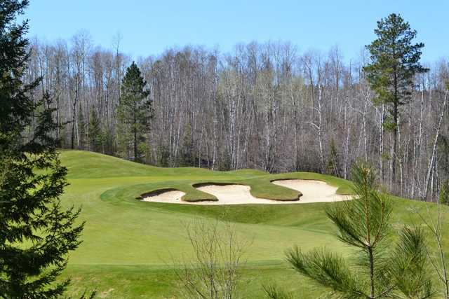 A view of green #12 protected by bunker at Legend Course from Giants Ridge Golf & Ski Resort