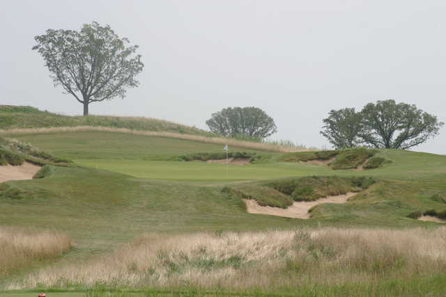 Bunkers surround the green on the 200-yard 16th hole at Erin Hills Golf Course.