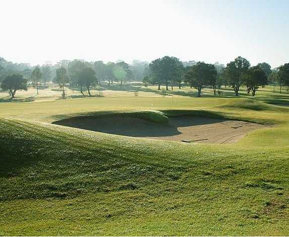 A view of green #18 protected by bunkers at Strathfield Golf Club