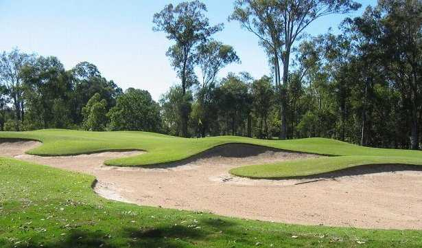 A view of green guarded by bunkers at Gailes Golf Club