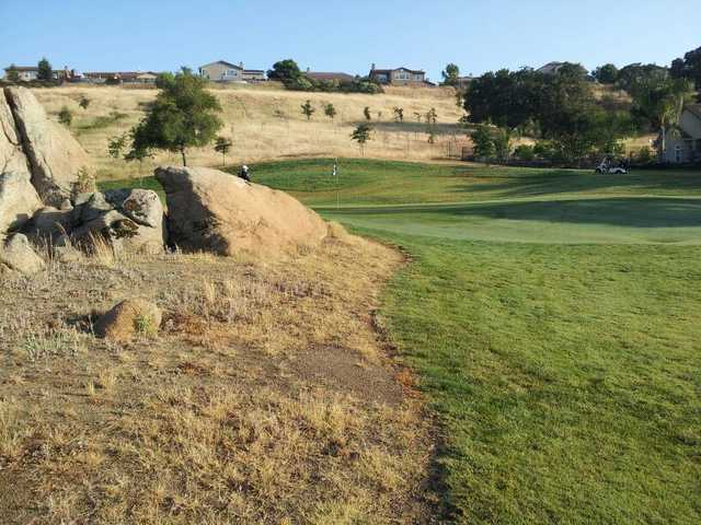 Large rocks guard the par-3 fourth at Whitney Oaks Golf Club