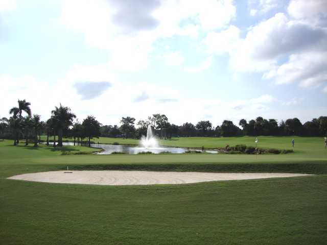 A view of a green with water fountain in background at Wyndemere Country Club