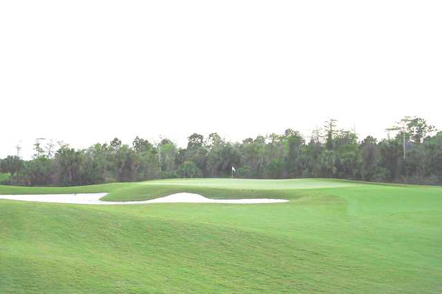 A view of a green guarded by sand trap at Golf Club of the Everglades