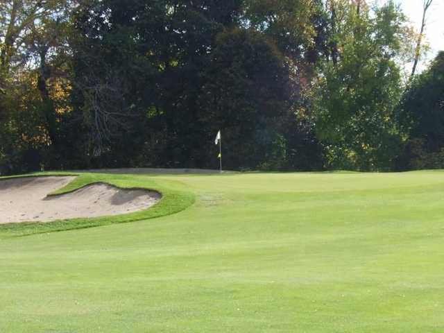 A view of the 3rd green with sand trap on the left side at Kent Country Club