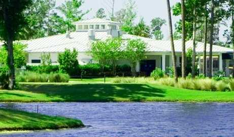 A view over the water of the clubhouse at Magnolia Plantation Golf Club