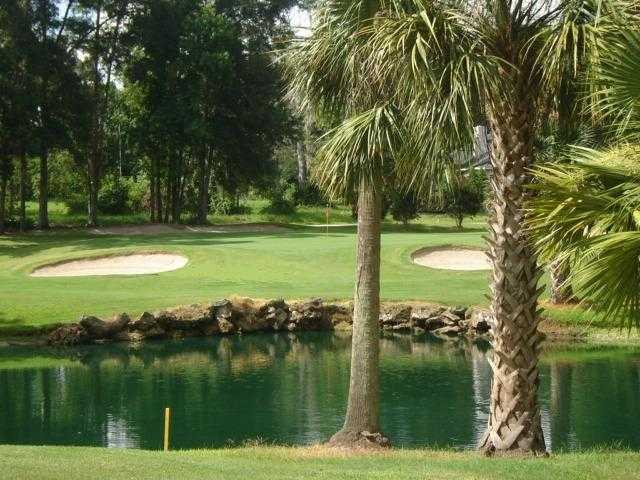 A view over the water of green at Country Club of Ocala