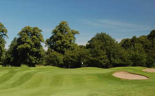 A view of green guarded by bunkers at Royal Musselburgh Golf Club