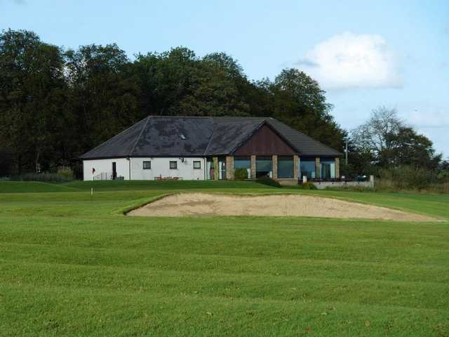 18th at Langlands Golf Club with clubhouse in background