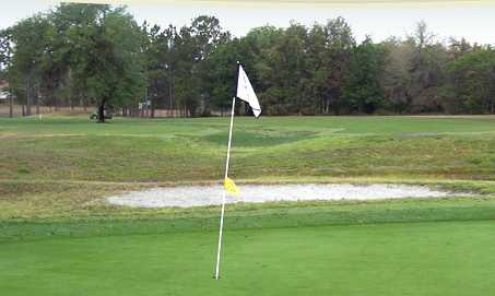 A view of a hole protected by bunker at Lake Diamond Golf & Country Club