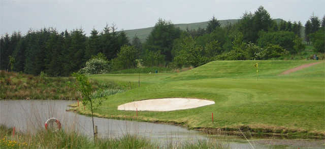 A view over the water of the 11th green at Eastwood Golf Club