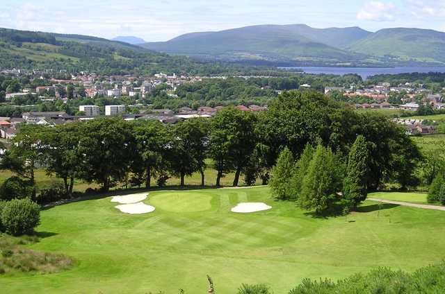 A view of a green protected by bunkers at Vale of Leven Golf Club