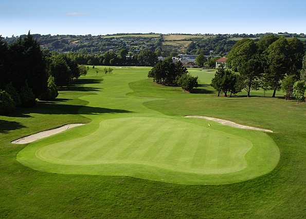 A view of a green protected by sand traps at Cork Golf Club