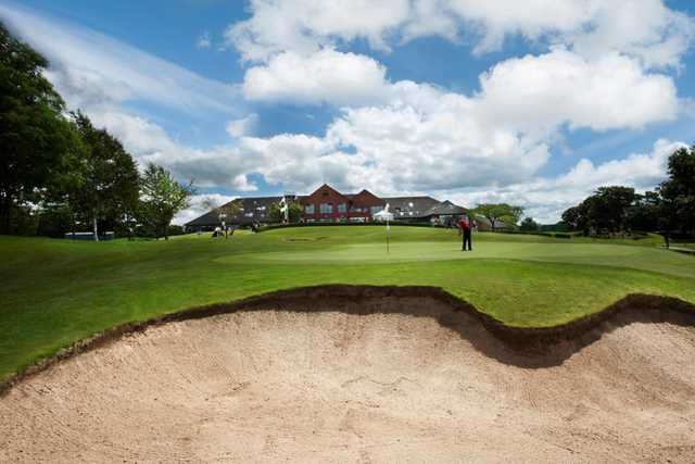 Panoramic view of the clubhouse, 18th green and greenside bunker at Tytherginton Golf Club