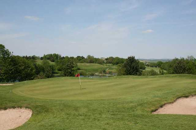 A view of green protected by bunkers at China Fleet Country Club