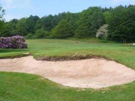 A view of the 4th green guarded by bunker at Chevin Golf Club