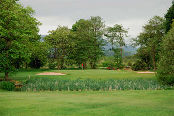 A view of a green flanked by bunkers at Clitheroe Golf Club