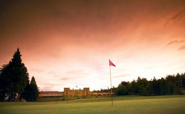 A view of a green with the clubhouse in background at Slaley Hall Hotel & Golf