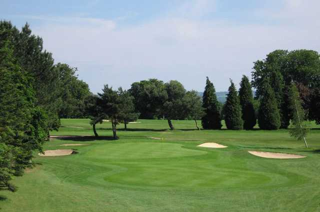 A view of a green protected by bunkers at Hoebridge Golf Centre
