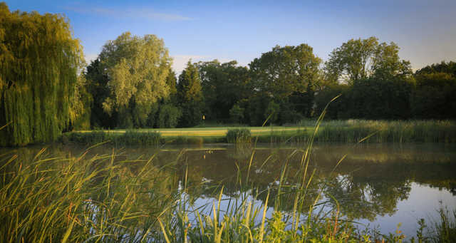 A view over the water of a hole at Horton Park Golf Club.