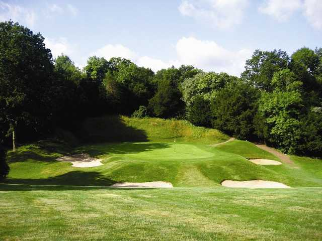 A view of the 1st green surrounded by bunkers at Purley Downs Golf Club