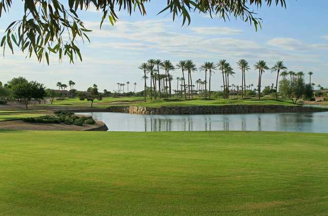A view over the water of green #7 at Cimarron Golf Club
