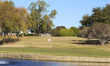 A view over the water of a hole at Eastern Hills Country Club